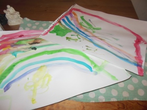 "Watercolor rainbows, and ""rainbow rivers,"" painted by my daughter's with the Husband.  They love art time, and art time with Daddy is even more special to them (somewhat to the chagrin of Mommy) ;))."